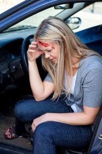 Woman in need of chiropractic care after an auto accident